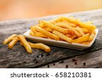 served french fries on plate... | Shutterstock . vector #658210381