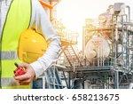 engineer hand holding helmet... | Shutterstock . vector #658213675