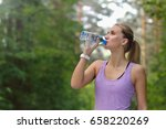 young adult woman drinking... | Shutterstock . vector #658220269