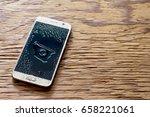 wet smartphone drops on wooden... | Shutterstock . vector #658221061