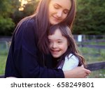 happy family moments in the park | Shutterstock . vector #658249801