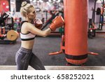 young pretty boxer woman... | Shutterstock . vector #658252021