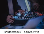 the skilled hands of a dj close ...   Shutterstock . vector #658264945