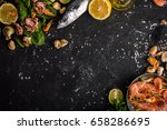 seafood on a dark background | Shutterstock . vector #658286695