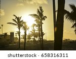 sunset at the beach with palm... | Shutterstock . vector #658316311