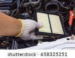 Small photo of Technician change a new car air filter, Put new wet air filter on car engine