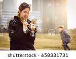 woman using mobile payments... | Shutterstock . vector #658331731