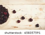 some cherries on a white wooden ... | Shutterstock . vector #658357591