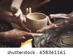 A Raw Clay Pot In The Hands Of...