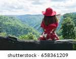 female tourists sitting alone... | Shutterstock . vector #658361209