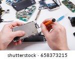 repairman disassembling... | Shutterstock . vector #658373215