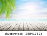 empty wooden table and palm... | Shutterstock . vector #658411525