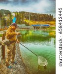 trout fishing on the lake.... | Shutterstock . vector #658413445