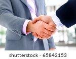 handshake isolated in office | Shutterstock . vector #65842153