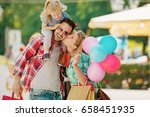 happy family walking along the... | Shutterstock . vector #658451935
