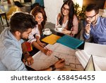 group of casual architects and... | Shutterstock . vector #658454455