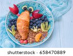 funny lobster croissant with... | Shutterstock . vector #658470889