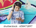 child with headset and phone on ... | Shutterstock . vector #658471897