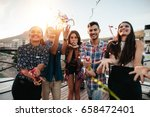 group of happy young people... | Shutterstock . vector #658472401
