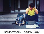Small photo of Traveller feel confused Trance with travel map,Backpacker to mistake,Feeling exhausted,Image for travel and freedom life concept