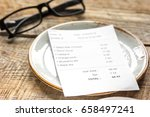 plate  glasses and check on... | Shutterstock . vector #658497241
