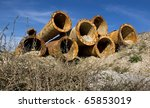 Abandoned rusty pipes from an old pipeline. - stock photo