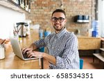 happy man working on laptop. in ... | Shutterstock . vector #658534351