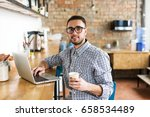 man working on laptop. in the... | Shutterstock . vector #658534489