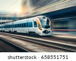high speed train in motion at... | Shutterstock . vector #658551751