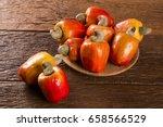 some cashew fruit over a wooden ... | Shutterstock . vector #658566529