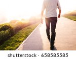 Low Section Of A Man Walking I...