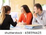 happy businesspeople talking... | Shutterstock . vector #658596625