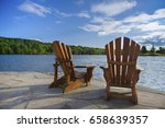 two wood muskoka chairs on a... | Shutterstock . vector #658639357
