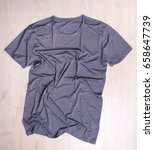 wrinkled gray t shirt on wooden ... | Shutterstock . vector #658647739