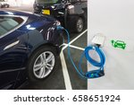electric vehicle on charging at ... | Shutterstock . vector #658651924