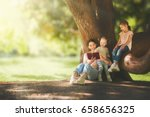 mother and daughters sitting... | Shutterstock . vector #658656325