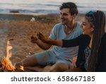 Couple On A Wild Beach Lit A...