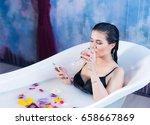 sexy brunette woman is sitting... | Shutterstock . vector #658667869