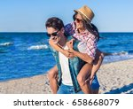 young funny couple in... | Shutterstock . vector #658668079