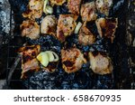 meat prepared on a grill. top... | Shutterstock . vector #658670935