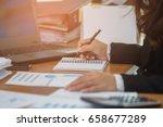 a business woman analyzing...   Shutterstock . vector #658677289