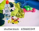 fitness equipment and pills on... | Shutterstock . vector #658683349