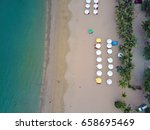 sandy beach with umbrellas and... | Shutterstock . vector #658695469