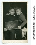 Vintage photo of brothers with a book (fifties) - stock photo
