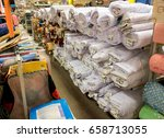rolls of fabric in a shop.... | Shutterstock . vector #658713055
