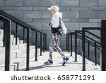 Small photo of Solemn senior woman jogging outdoor on stone steps with handrails