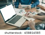 young hipster worker writing on ... | Shutterstock . vector #658816585