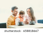 smiling family with a child | Shutterstock . vector #658818667