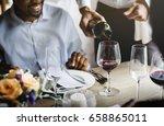 restaurant staff poring serving