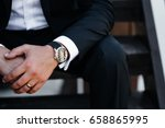 man's watch on hand. classic... | Shutterstock . vector #658865995